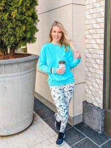bright blue sweater and coffee